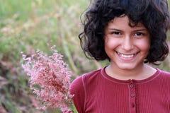 Latina graziosa con i fiori Immagine Stock Libera da Diritti