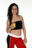 Latina joven con el zumo de naranja Foto de archivo libre de regalías