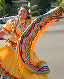 Latina Lady dancer in traditional dress. Latina dancer in traditional costume dancing at a street parade. Photo taken on October 2 2011, in Yountville California Royalty Free Stock Image