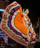 Latina Lady dancer in traditional dress. Latina dancer in traditional costume dancing at a street parade Royalty Free Stock Image