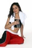Latina mit Wasser-Flasche Stockfotos