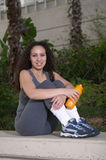 Latina with Orange Sports Water Bottle. Young Latina with Orange Sports Water Bottle Stock Images