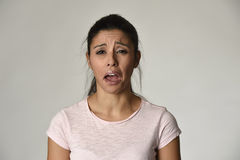 Latina sad woman serious and concerned crying desperate overacting on feeling depressed. Young beautiful latina sad woman serious and concerned crying desperate Royalty Free Stock Photography