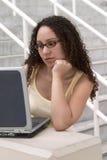 Latina Student at Computer wearing Glasses Royalty Free Stock Photos