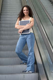 Latina Student Hugging on Escalator. Young Latina Student Hugging on Escalator Royalty Free Stock Images