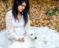 Latina teen outside with pet dog and rat. Latina teenage girl sitting outside in the autumn leaves with her pet dog and rat Royalty Free Stock Photos