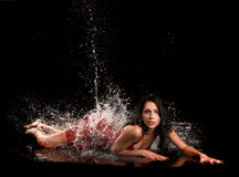 Latina Woman Being Splashed With Water Royalty Free Stock Images