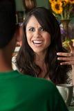 Latina Woman with Cofee or Tea and Male Companion Royalty Free Stock Photo