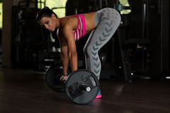 Latina Woman Doing Heavy Weight Exercise For Back Royalty Free Stock Image
