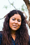 Latina woman portrait outdoors. Latina serene woman portrait posing outside Stock Image