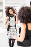 Latina Woman shopping fashion dress in store Stock Photography