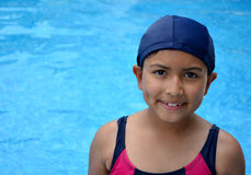 Latinamerican girl in the swimming pool. Stock Photography
