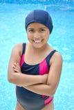 Latinamerican girl in the swimming pool. Stock Photos