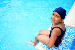 Latinamerican girl in the swimming pool. Stock Image
