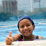 Latinamerican girl in the swimming pool. Royalty Free Stock Photos