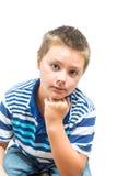 Latinamerikan-amerikanen barnet vilar Chin On Hand During Picture arkivfoton