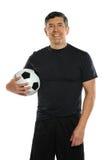 Latinamerikansk boll för manHoldingfotboll royaltyfria foton