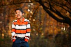 Latinamerikansk pojke i Forest Preserve royaltyfria foton