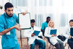 Latine Doctor With Paper Notes. Doctor`s Meeting. royalty free stock photo