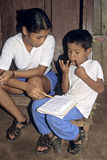 Latino boy and teacher during arithmetic lesson Royalty Free Stock Photo