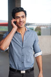 Latino businessman on phone. Handsome, young latino businessman talking on the cell phone Royalty Free Stock Photos