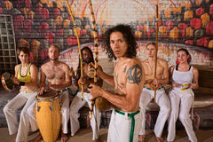 Latino Capoeira Performer with Group stock photo
