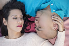 Latino Couple Laying Down Royalty Free Stock Photos