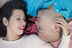 Latino Couple Laying Down Stock Images