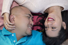 Latino Couple Laying Down Royalty Free Stock Image