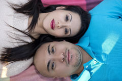 Latino Couple Laying Down Stock Photo
