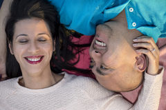 Latino Couple Laying Down Stock Image