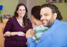 Latino Couple with Surrogate Mother Royalty Free Stock Image