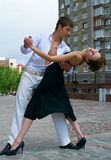 Latino dance. Young couple dancing Latino dance against urban landscape Stock Photography