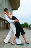 Latino dance. Young couple dancing Latino dance against urban landscape Royalty Free Stock Image