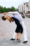 Latino dance. Young couple dancing Latino dance against urban landscape Royalty Free Stock Photo