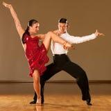 Latino dance couple in action - dancing wild samba Royalty Free Stock Images