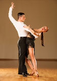 Latino dance couple in action - dancing wild samba Royalty Free Stock Photography