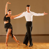 Latino dance couple in action - dancing wild samba. A latino dance couple in action - dancing wild samba Royalty Free Stock Photos
