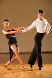 Latino dance couple in action - dancing wild samba Royalty Free Stock Images