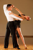 Latino dance couple in action - dancing wild samba Stock Images