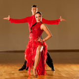 Latino dance couple in action - dancing wild samba stock image