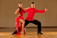 Latino dance couple in action - dancing wild samba Royalty Free Stock Image