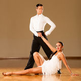 Latino dance couple in action - dancing wild samba Stock Photos