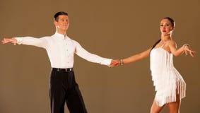 Latino dance couple in action, dancing wild samba Stock Images