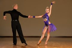 Latino dance couple in action preforming a exhibition dance - w. Ild samba stock photography