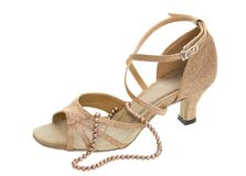 Latino dance shoes and pearl necklace isolated Royalty Free Stock Image