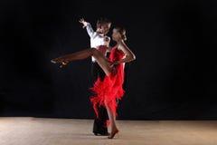 Latino dancers in ballroom Stock Photography