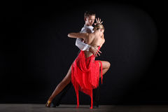 Latino dancers in ballroom Stock Photography