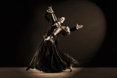 Latino dancers in ballroom. Against black background Royalty Free Stock Images