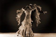 Latino dancers in ballroom. Against black background Stock Photo